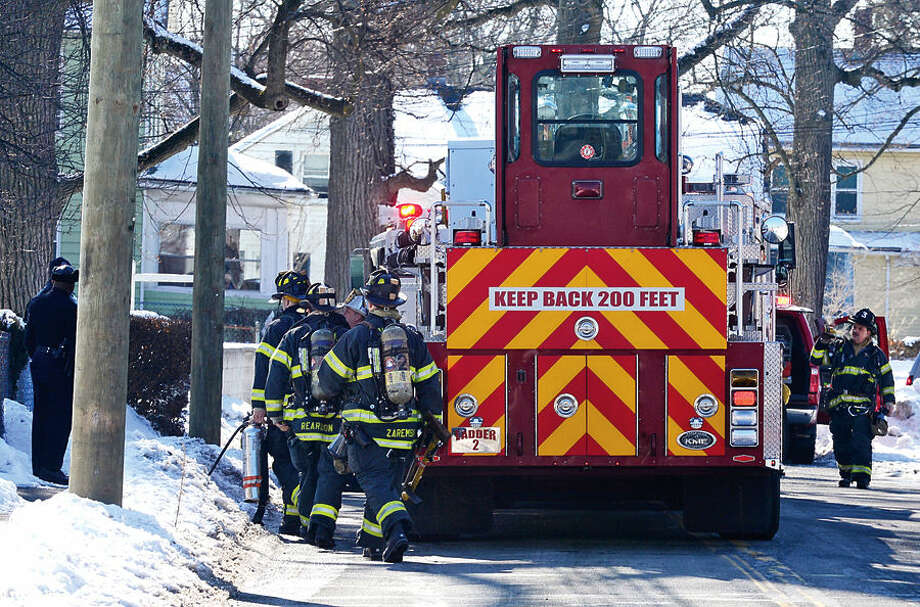 Hour photo / Erik Trautmann Norwalk firefighters respond to a fire call at 114 Woodward Ave Saturday morning where a pipe burst realeasing steam into the apartments.