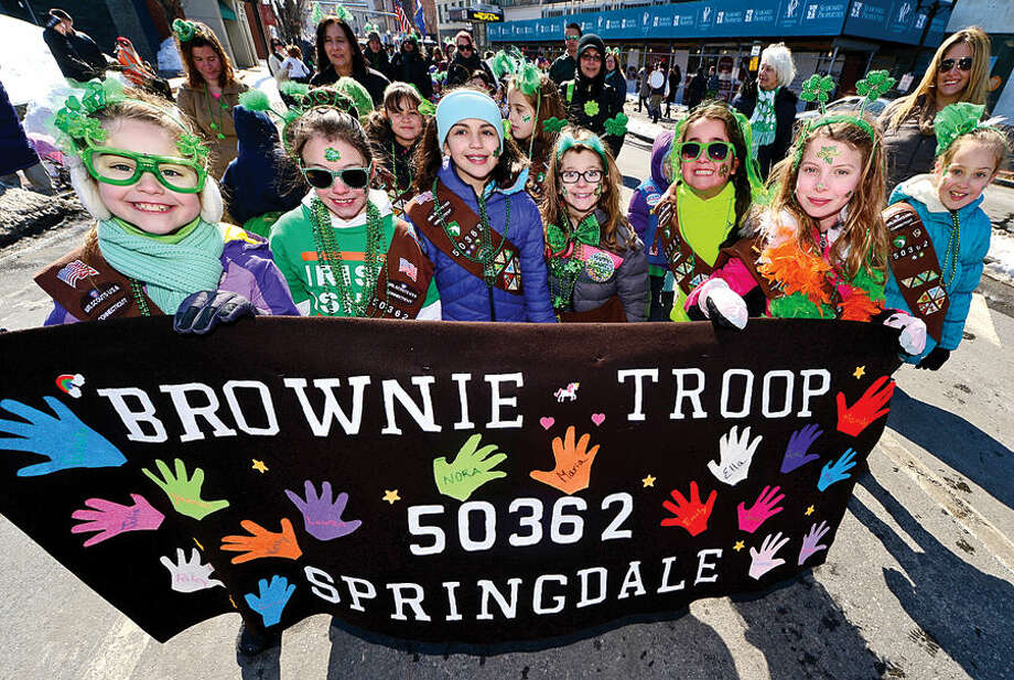 Hour photo / Erik Trautmann Stamford St Patrick's Day Parade participants and local residents including Brownie Troop 50362 enjoy the sunny Saturday afternoon as the procession proceeds down Bedford St.