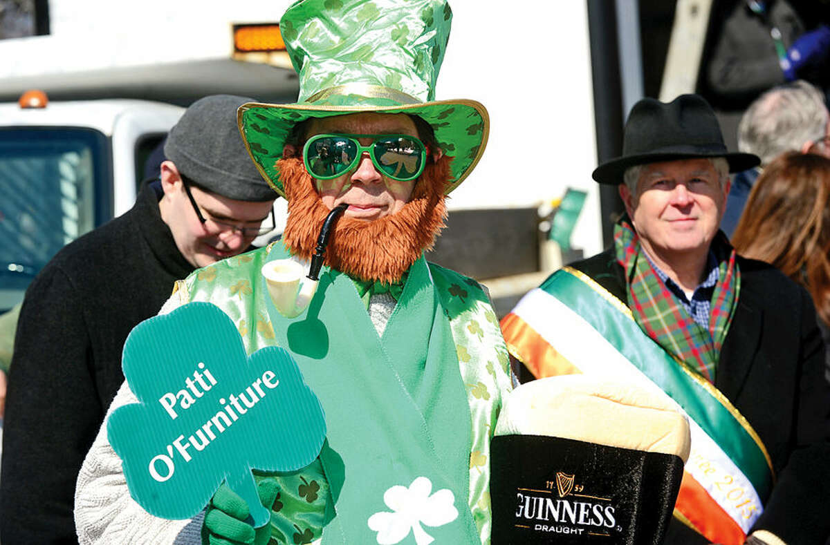 Hour photo / Erik Trautmann Stamford St Patrick's Day Parade participants and local residents including Patrick King enjoy the sunny Saturday afternoon as the procession proceeds down Bedford St.