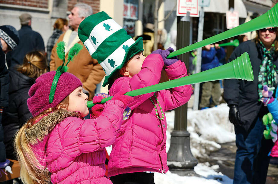 Hour photo / Erik Trautmann Stamford St Patrick's Day Parade participants and local residents including Sophie and Maya Berry enjoy the sunny Saturday afternoon as the procession proceeds down Bedford St.