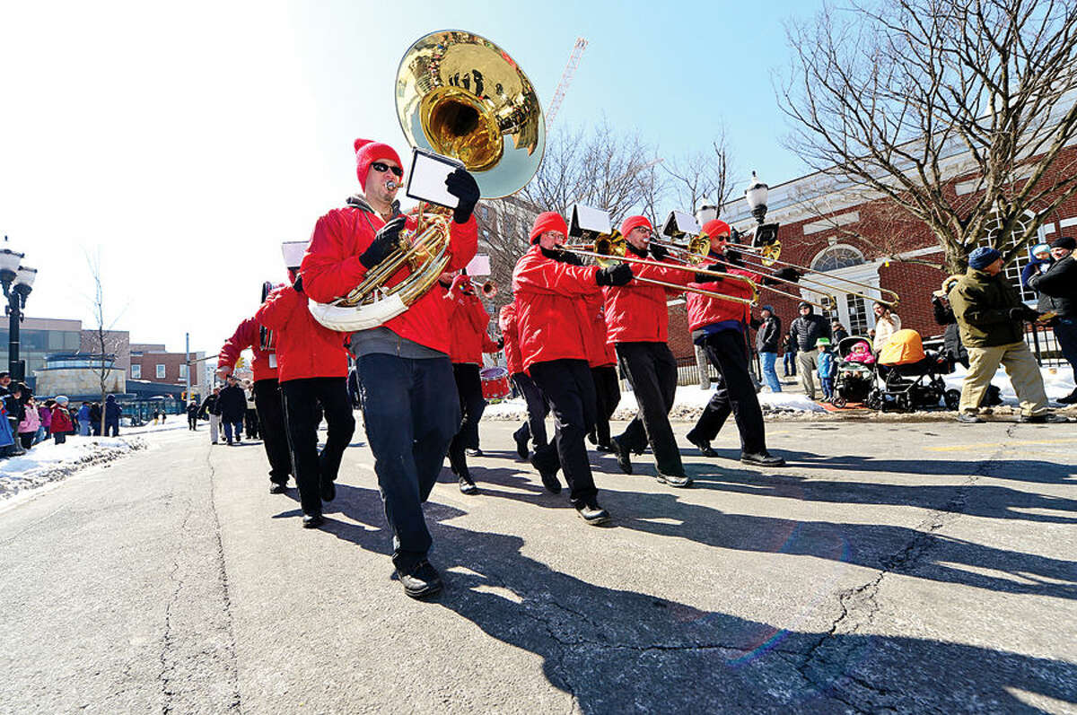 Hour photo / Erik Trautmann Stamford St Patrick's Day Parade participants and local residents including the Dixie Dandies enjoy the sunny Saturday afternoon as the procession proceeds down Bedford St.