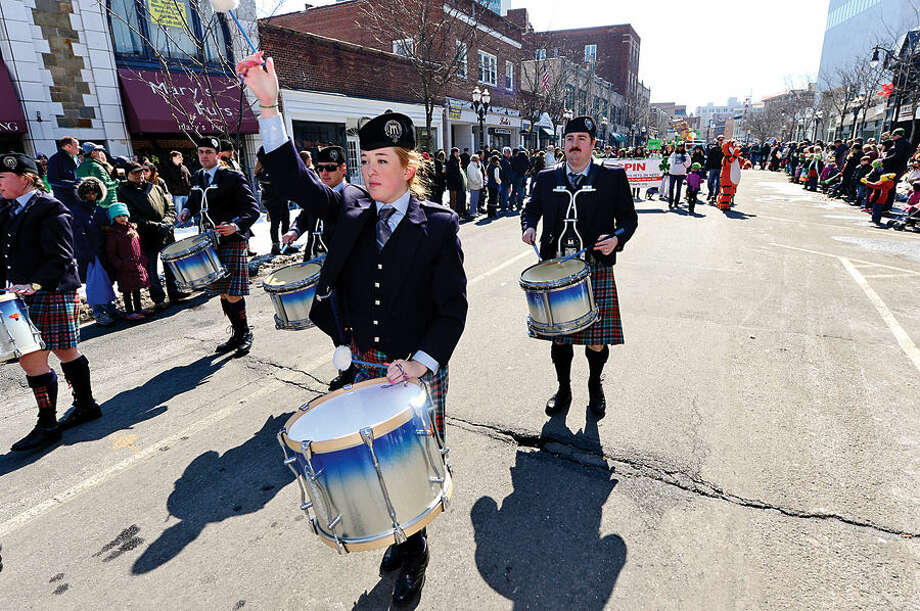 Hour photo / Erik Trautmann Stamford St Patrick's Day Parade participants and local residents including the NY Metro Pipe Band enjoy the sunny Saturday afternoon as the procession proceeds down Bedford St.