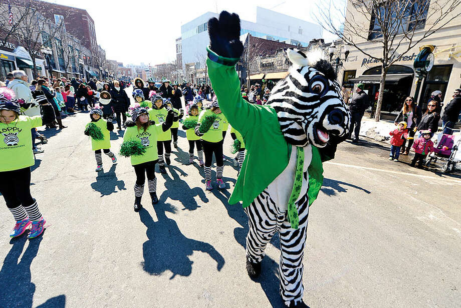 Hour photo / Erik Trautmann Stamford St Patrick's Day Parade participants and local residents including Marchers from Zebra Entertainment enjoy the sunny Saturday afternoon as the procession proceeds down Bedford St.