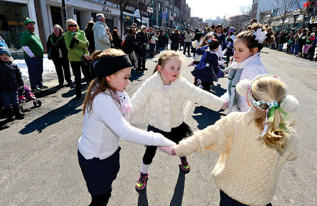 Hour photo / Erik Trautmann Stamford St Patrick's Day Parade participants and local residents including dancers with Anam Cara Irish Dance School enjoy the sunny Saturday afternoon as the procession proceeds down Bedford St.