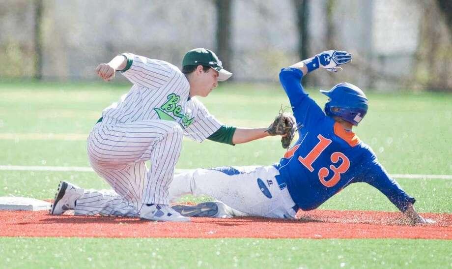 Norwalk High School's Thomas Benincaso puts the tag on Danbury High School runner Derek Garnett at second in a game played at Norwalk. Wednesday, April 13, 2016