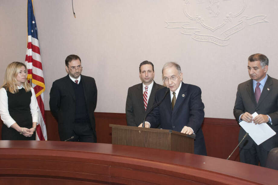 State Sens. Martin Looney, Bob Duff and Carlo Leone speak about sudden cardiac arrest, a deadly condition that can claim the lives of otherwise healthy and athletic individuals, especially young people. They proposed legislation to raise awareness of the condition in public schools and at student athletic events. With them are Victor Peña of Darien, father of Andy Peña, who died of sudden cardiac arrest just one month shy of 15, and advocate Vicki O'Rourke, also of Darien.