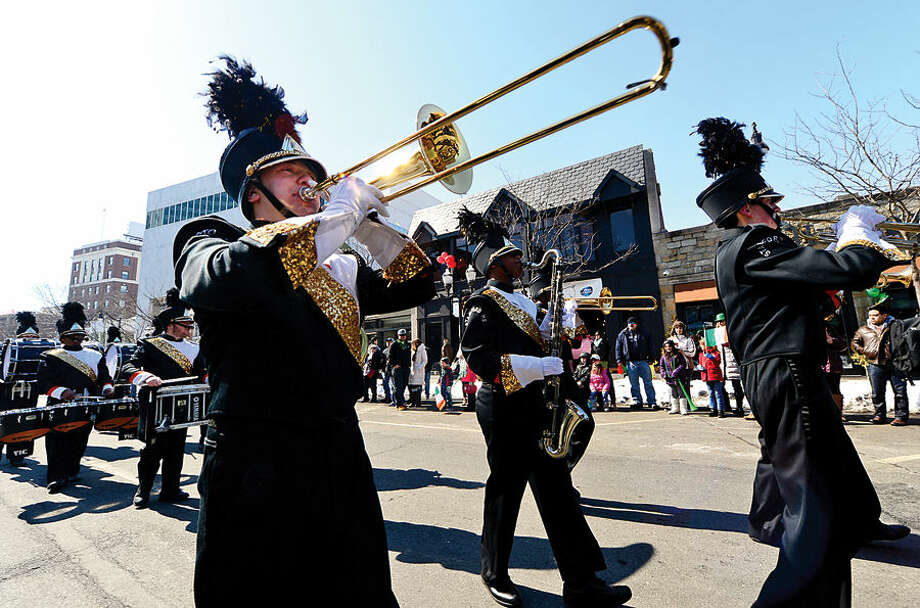 Hour photo / Erik Trautmann Stamford St Patrick's Day Parade participants and local residents including the Stamford High School Marching Band enjoy the sunny Saturday afternoon as the procession proceeds down Bedford St.