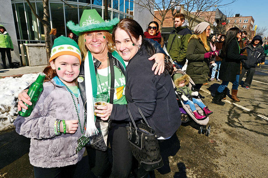 Hour photo / Erik Trautmann Stamford St Patrick's Day Parade participants and local residents including Grace Darling, and Sheila and Kathleen Brennan, enjoy the sunny Saturday afternoon as the procession proceeds down Bedford St.