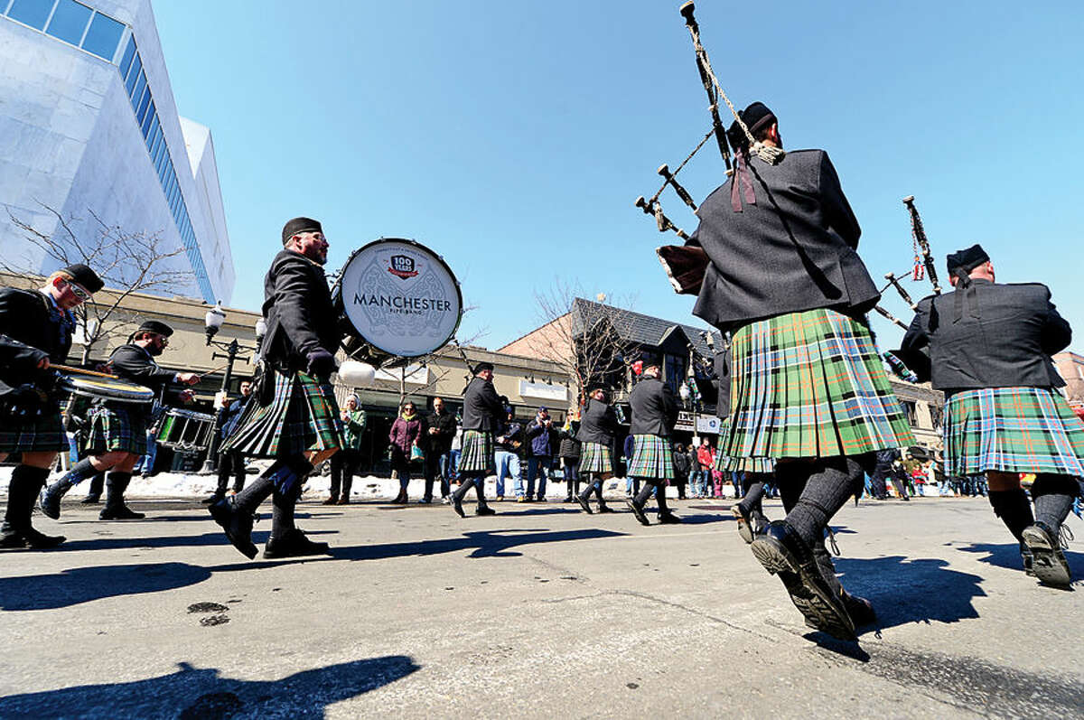 Hour photo / Erik Trautmann Stamford St Patrick's Day Parade participants and local residents including the Manchester Pipe Band enjoy the sunny Saturday afternoon as the procession proceeds down Bedford St.