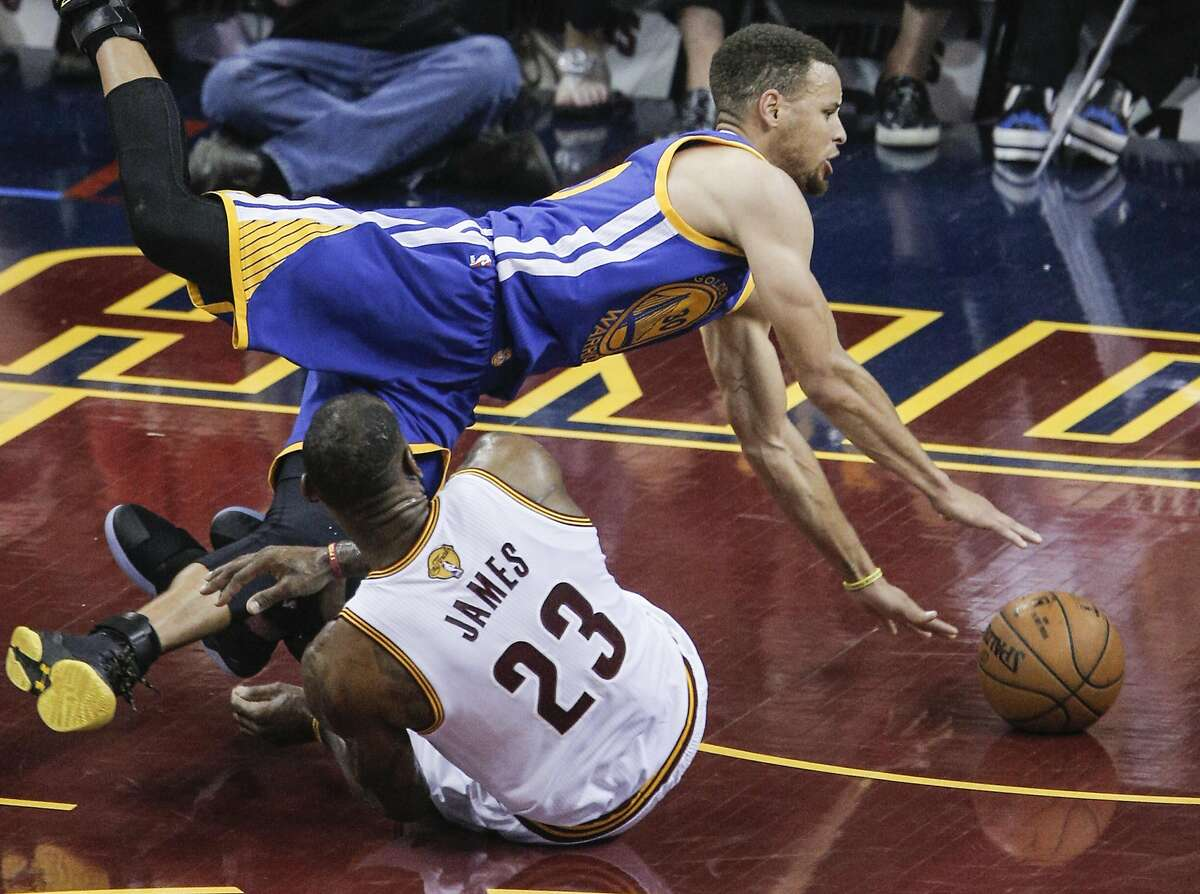 Golden State Warriors' Stephen Curry trips over Cleveland Cavaliers' LeBron James in the first quarter during Game 4 of the NBA Finals at The Quicken Loans Arena on Friday, June 10, 2016 in Cleveland, Ohio.