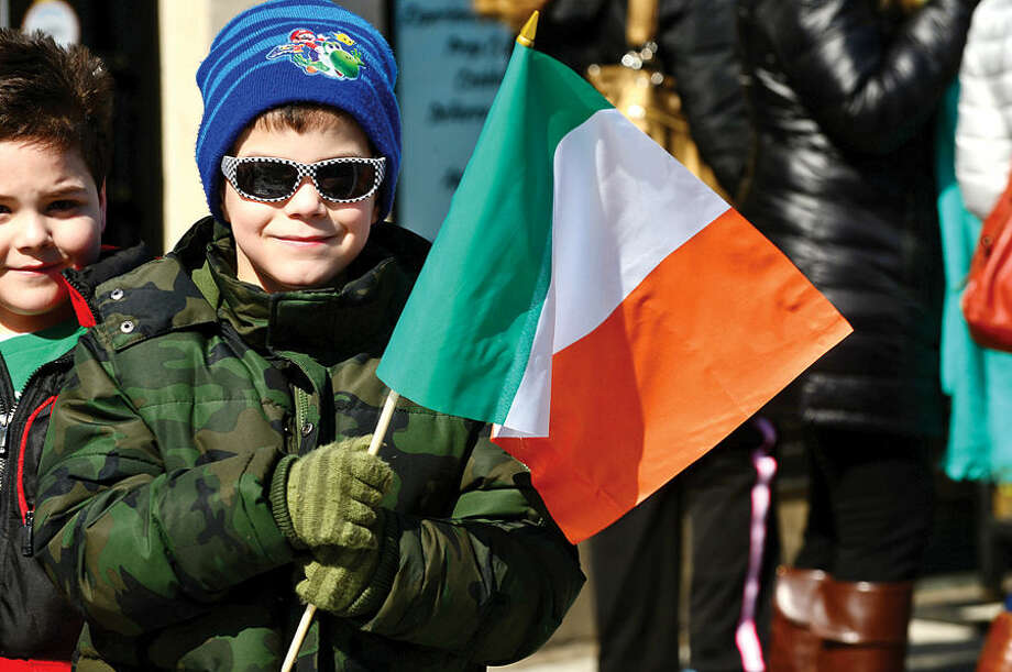 Hour photo / Erik Trautmann Stamford St Patrick's Day Parade participants and local residents including Jack Butler, 6, enjoy the sunny Saturday afternoon as the procession proceeds down Bedford St.