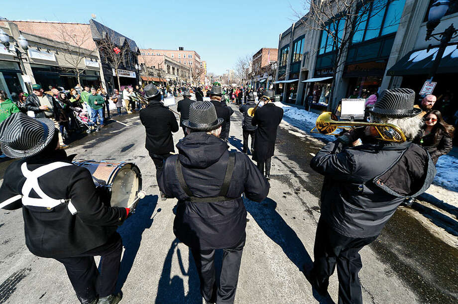 Hour photo / Erik Trautmann Stamford St Patrick's Day Parade participants and local residents enjoy the sunny Saturday afternoon as the procession proceeds down Bedford St.