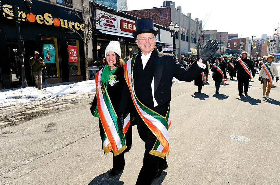 Hour photo / Erik Trautmann Stamford St Patrick's Day Parade participants and local residents including parade grand marshals Bill and Evon enjoy the sunny Saturday afternoon as the procession proceeds down Bedford St.