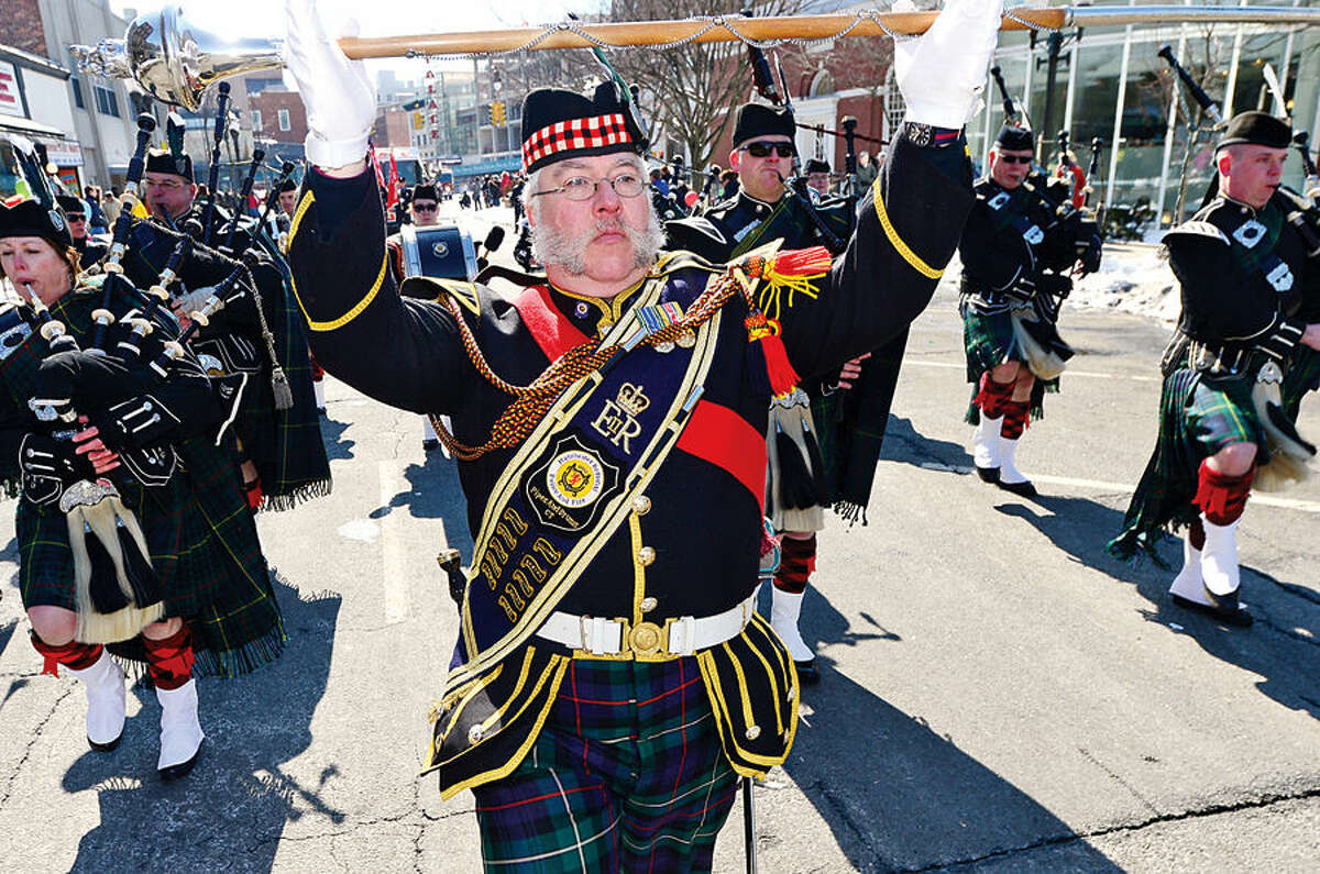 Hour photo / Erik Trautmann Stamford St Patrick's Day Parade participants and local residents including the drum major of the Machester County Police and Fire Pipe Band enjoy the sunny Saturday afternoon as the procession proceeds down Bedford St.
