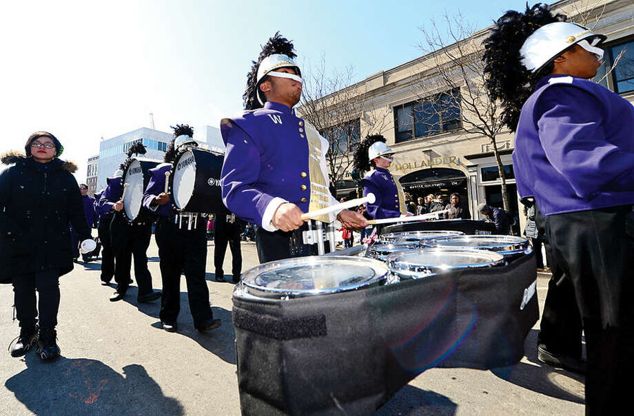 Hour photo / Erik Trautmann Stamford St Patrick's Day Parade participants and local residents including the Westhill High School Marching Band enjoy the sunny Saturday afternoon as the procession proceeds down Bedford St.