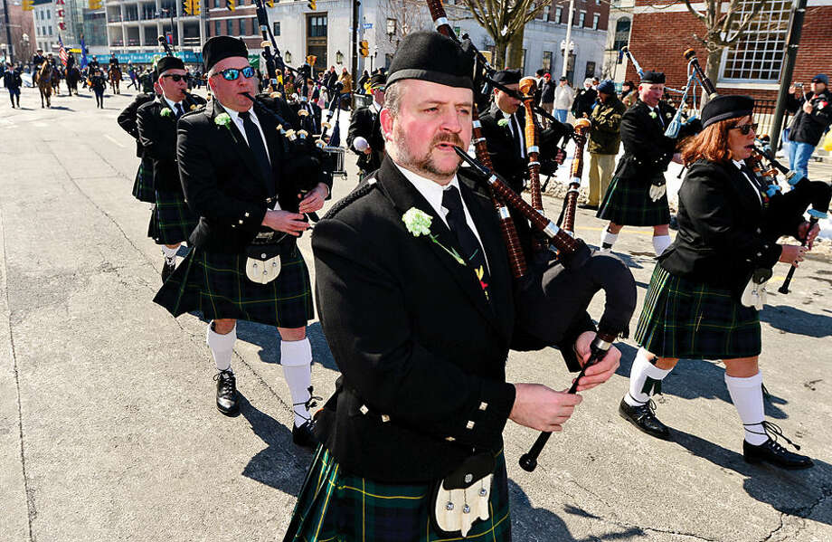 Hour photo / Erik Trautmann Stamford St Patrick's Day Parade participants including the GReenwich Pipe Band enjoy the sunny Saturday afternoon as the procession proceeds down Bedford St.