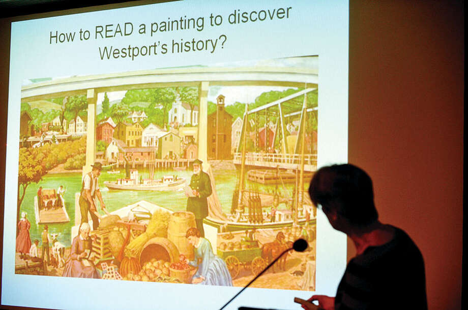 "Hour photo / Erik Trautmann Town Curator Kathie Bennewitz speaks the Westport Historical Society's exhibit, ""Saugatuck@Work"", in the context of artist Robert L. Lambdin's restored mural, ""Saugatuck in the 19th Century"" Saturday at the Westport Public Library."