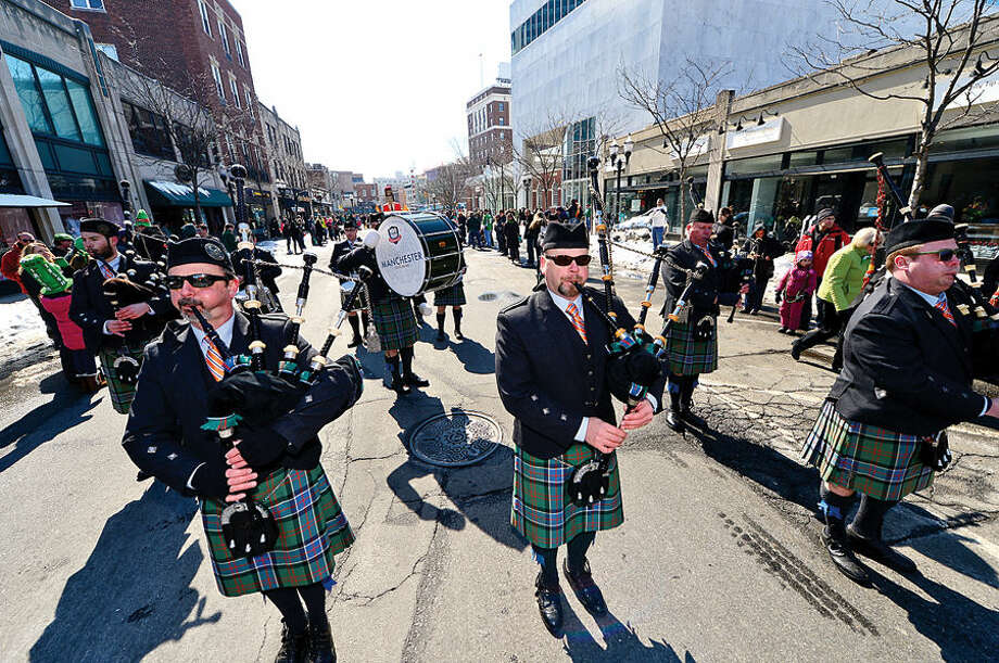 Hour photo / Erik Trautmann Stamford St Patrick's Day Parade participants including the Manchester Pipe Bandenjoy the sunny Saturday afternoon as the procession proceeds down Bedford St.