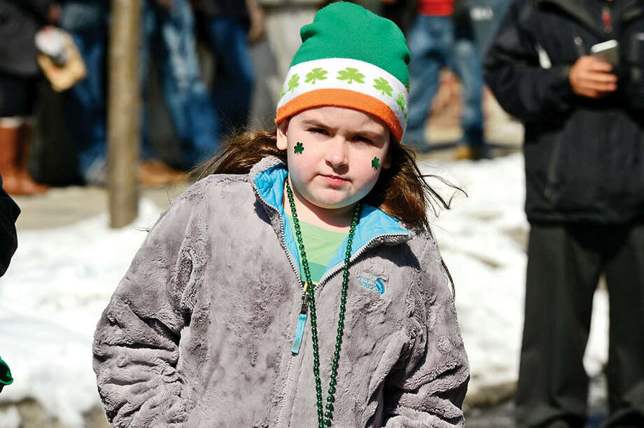 Hour photo / Erik Trautmann Stamford St Patrick's Day Parade participants and local residents including Grace darling, 7, enjoy the sunny Saturday afternoon as the procession proceeds down Bedford St.