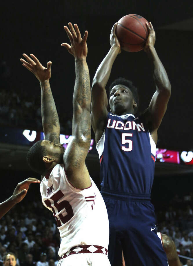 Connecticut's Daniel Hamilton (5) takes a shot over Temple guard Jaylen Bond (15) in the first half of an NCAA college basketball game, Saturday, March 7, 2015, in Philadelphia. (AP Photo/Laurence Kesterson)