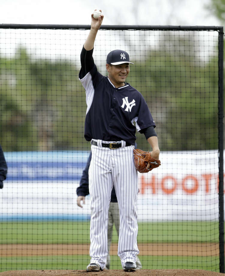 New York Yankees starting pitcher Masahiro Tanaka, of Japan, loosens up before throwing in a simulated game during a spring training baseball workout, Saturday, March 7, 2015, in Tampa, Fla. (AP Photo/Lynne Sladky)