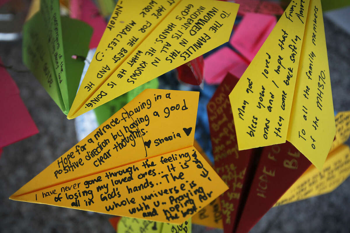 FILE - In this March 15, 2014, photo, paper planes with personalized messages for the missing on Malaysia Airlines Flight 370, are placed at the viewing gallery of Kuala Lumpur International Airport in Sepang, Malaysia. For centuries, human beings have clambered aboard vessels and sailed past the horizon, unsure whether they would return. Sometimes they didn't. Today, the world is a year into the vexing disappearance of an enormous jetliner without any sort of resolution, a mystery more enduring than the rest. (AP Photo/Wong Maye-E, File)