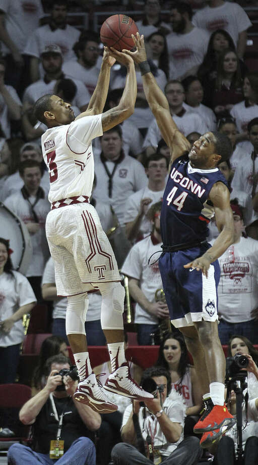 Temple guard Jesse Morgan (3) takes a shot past Connecticut guard Rodney Purvis (44) in the first half of an NCAA college basketball game, Saturday, March 7, 2015, in Philadelphia. (AP Photo/Laurence Kesterson)