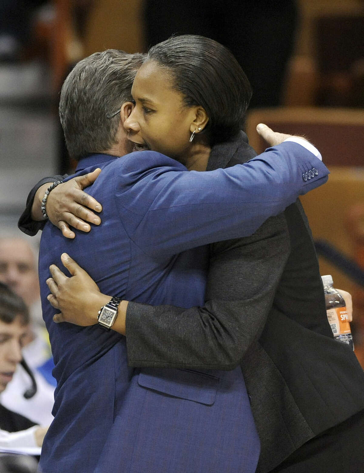 Connecticut head coach Geno Auriemma and Cincinnati head coach Jamelle Elliott hug after Connecticut's 93-34 victory in an NCAA college basketball game in the quarterfinals of the American Athletic Conference tournament in Uncasville, Conn., on Saturday, March 7, 2015. (AP Photo/Fred Beckham)