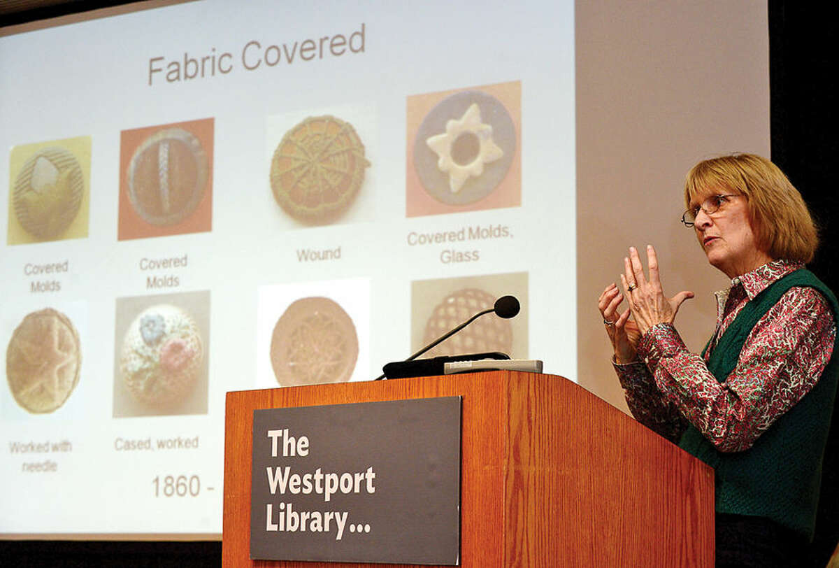 """Hour photo / Erik Trautmann Rachel Mercurio, vice president of the Connecticut State Button Society, speaks about Saugatuck button makers in the context of artist Robert L. Lambdin's restored mural, """"Saugatuck in the 19th Century"""" during a presentation at the Westport Public Library Saturday, Women of """"Saugatuck@Work"""""""
