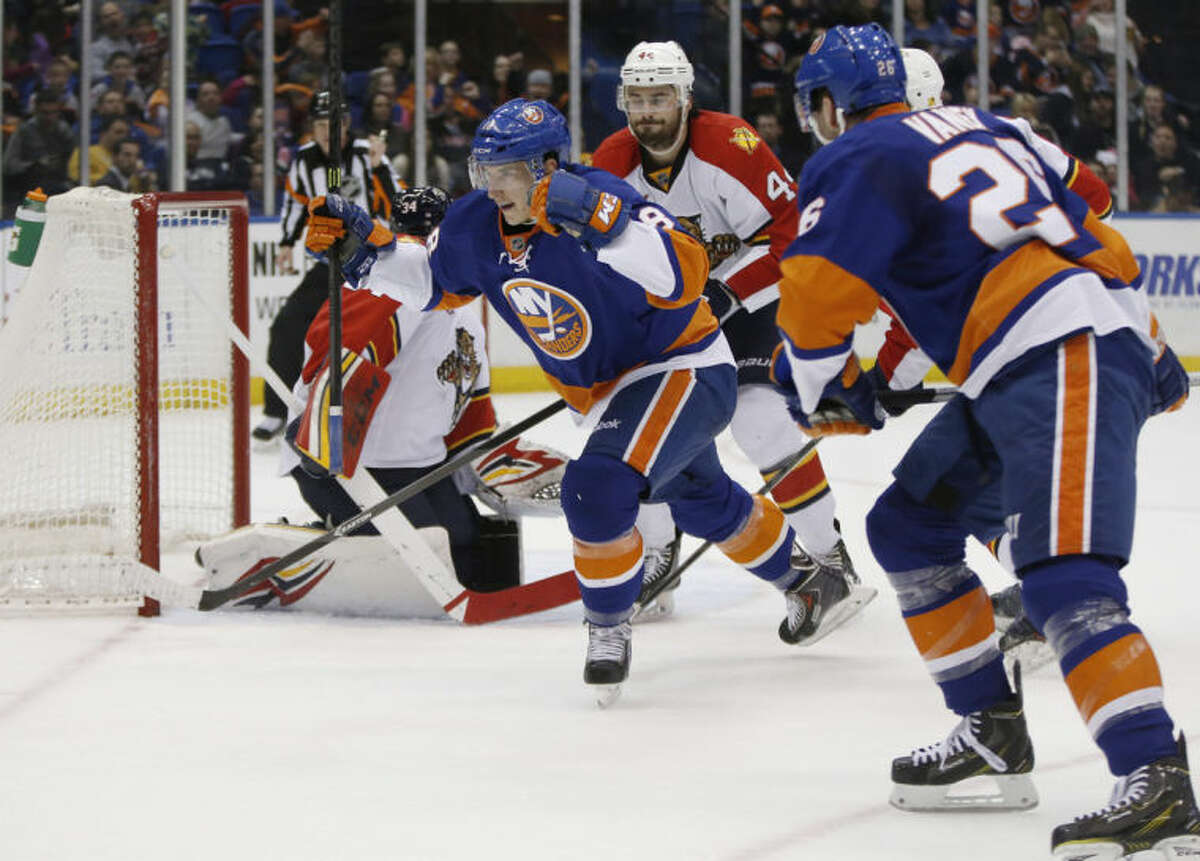 New York Islanders center Ryan Strome (18), center, celebrates after scoring in the second period of an NHL hockey game against the Florida Panthers in Uniondale, N.Y., Sunday, March 2, 2014. (AP Photo/Kathy Willens)