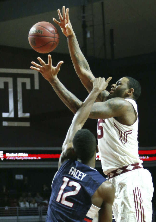 Temple guard Devin Coleman (15) is fouled by Connecticut forward Kentan Facey (12) in the second half of an NCAA college basketball game, Saturday, March 7, 2015, in Philadelphia. Temple won 75-63. (AP Photo/Laurence Kesterson)