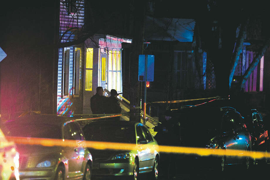 "Madison Police investigate the scene of a shooting on Williamson Street, late Friday, March 6, 2015 in Madison, Wis. A 19-year-old black man died Friday night after being shot by an officer in Madison, authorities said. The man was shot after an altercation with the officer and died at a hospital, Police Chief Mike Koval said. He did not know if the man was armed, but said the ""initial findings at the scene did not reflect a gun or anything of that nature that would have been used by the subject. (AP Photo/Wisconsin State Journal, Steve Apps)"