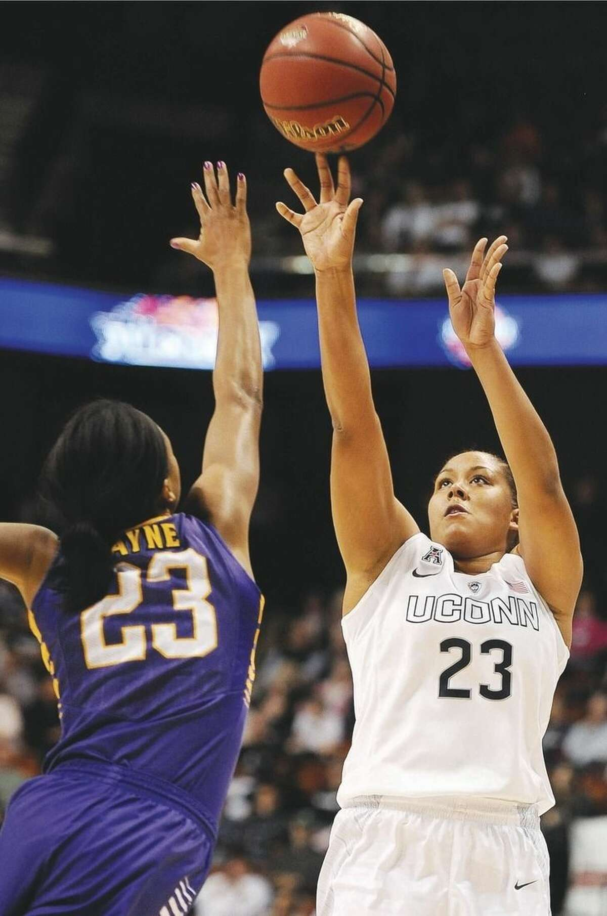 AP photo UConn's Kaleena Mosqueda-Lewis, right, shoots over East Carolina's Jada Payne, during the first half of the AAC tournament semifinals on Sunday.