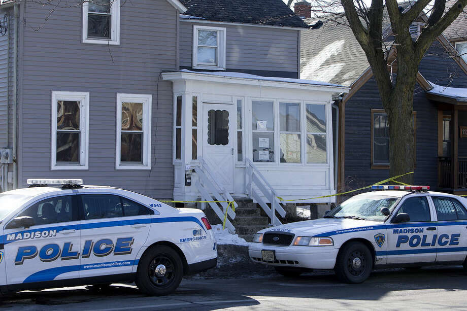 """Madison Police rope the scene of a police involved shooting at a home in Madison, Wis., on Saturday, March 7, 2015. A 19-year-old black man died Friday night after being shot by a police officer in Madison, authorities said. The man was shot after an altercation with the officer and died at a hospital. The officer did not know if the man was armed, but according to Police Chief Mike Koval, """"initial findings at the scene did not reflect a gun or anything of that nature that would have been used by the subject. (AP Photo/Wisconsin State Journal, Steve Apps)"""