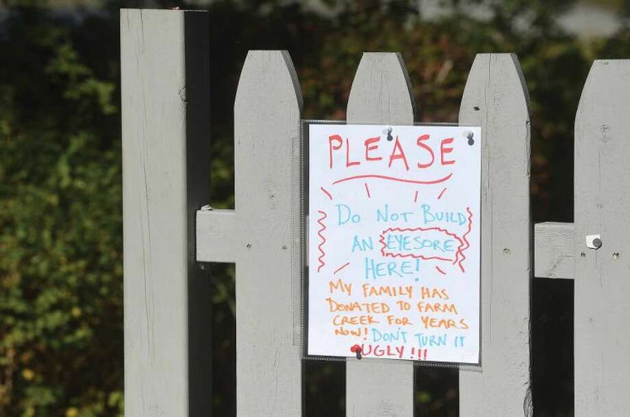 Hour Photo/Alex von Kleydorff Sign on a fence leading to Nearwater Dr across from farm Creek Preserve