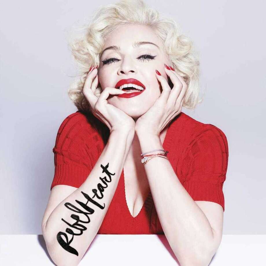 "This CD cover image released by Interscope Records shows the delux album ""Rebel Heart,"" the latest release by Madonna. (AP Photo/Interscope Records)"