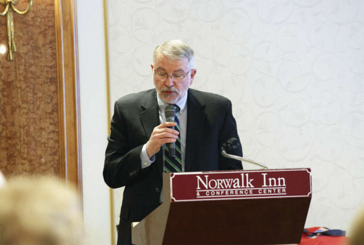 Jeffrey S. Smith accepts his induction to the Norwalk High School Alumni Association's Honor Roll Sunday afternoon at The Norwalk Inn. Hour Photo / Danielle Calloway