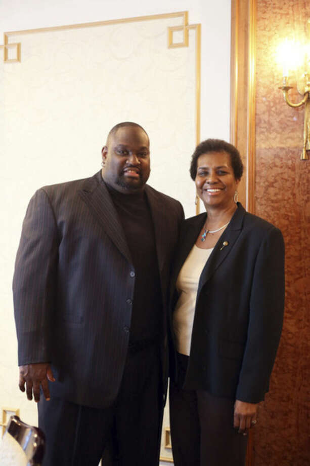 "Hour photo/Danielle CallowayBaseball great and Norwalk native Maurice ""Mo"" Vaughn surprised his sister, Catherine Vaughn, Sunday when she was among four Norwalk High School alumni installed on the NHS Alumni Association Teacher Honor Roll. ""Mo,"" the onetime Boston Red Sox slugger and American League Most Valuable Player in 1995, has done extremely well in real estate development in retirement and also runs a transportation company in Ohio where he lives with his wife, Gail Turkovich-Vaughn, whom he met while playing with the Cleveland Indians, and their two children."