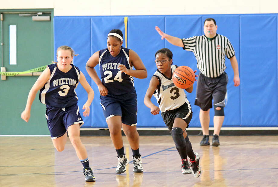 Norwalk's #3, Tamia Fulton, dribbles the ball during the Fairfield County Basketball League 8th Grade Girls Championship Game against Wilton at Middlesex Middle School in Darien Sunday afternoon. Hour Photo / Danielle Calloway