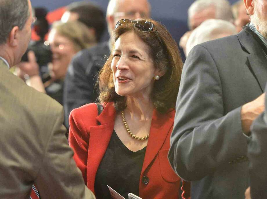 Hour Photo/Alex von Kleydorff 143 District State Rep. Gail Lavielle talks with friends during Republican Presidential candidate John Kasich Town Hall Meeting at Sacred Heart University in Fairfield Conn. on Friday