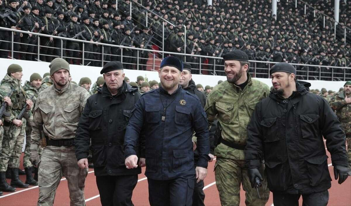 """FILE - In this file photo taken on Monday, Dec. 9, 2015, Chechnya's regional leader Ramzan Kadyrov, center, and other Chechen top commanders inspect Chechen special forces during a a rally at a stadium in Chechen capital Grozny, Russia. Russian President Vladimir Putin bestowed a state award Monday on the leader of Chechnya, the North Caucasus strongman who hailed the suspected killer of an opposition politician as a """"true patriot.""""Kadyrov drew criticism Sunday from government opponents after praising Zaur Dadayev, a Chechen suspect in the murder of Kremlin foe Boris Nemtsov. (AP Photo/Musa Sadulayev, file)"""