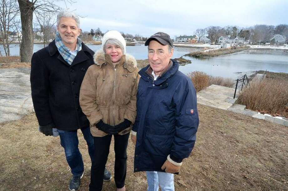 Hour Photo/Alex von Kleydorff Bruce Beinfield, Norwalk Land Trust President Kathy Siever and Chuck Schoendorf , Founder Farm Creek Preserve, stand across from the Nearwater Lane property that Bruce Beinfield will make avaalable to the trust.