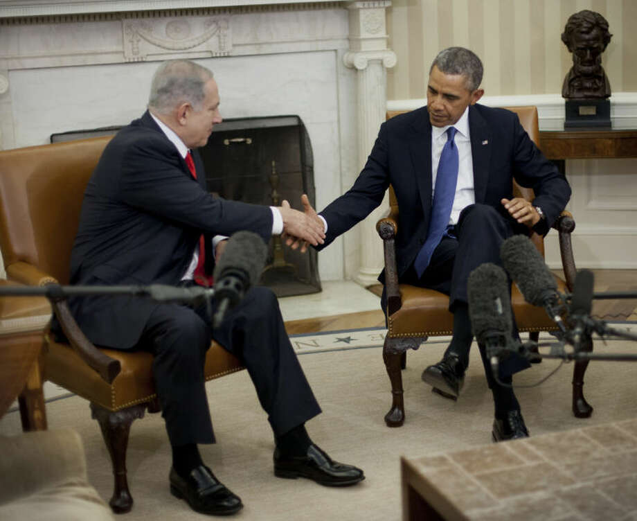 President Barack Obama and Israeli Prime Minister Benjamin Netanyahu shakes hands in the Oval Office of the White House in Washington, Monday, March 3, 2014. Seeking to keep a pair of delicate diplomatic efforts afloat, Obama will personally appeal to Netanyahu to move forward on peace talks with the Palestinians, while also trying to manage Israel's deep suspicion of his pursuit of a nuclear accord with Iran. (AP Photo/Pablo Martinez Monsivais)