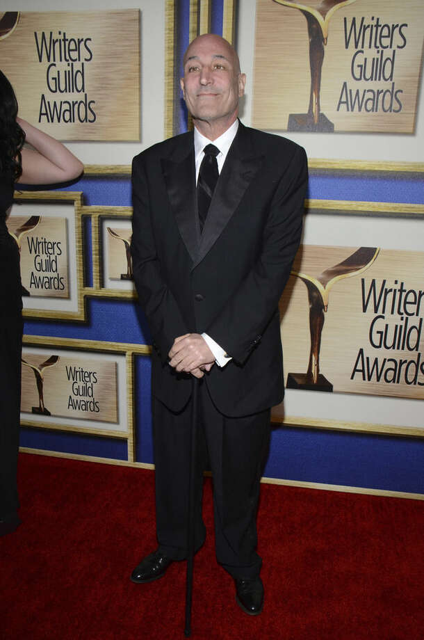 "FILE - In this Feb. 1, 2014 file photo, Sam Simon arrives at the Writers Guild Awards, in Los Angeles. Simon, a co-creator of ""The Simpsons"" who made a midlife career shift into philanthropy and channeled much of his personal fortune into social causes including animal welfare, has died Sunday, March 8, 2015, after a long bout with cancer. He was 59. (Photo by Tonya Wise/Invision/AP, File)"