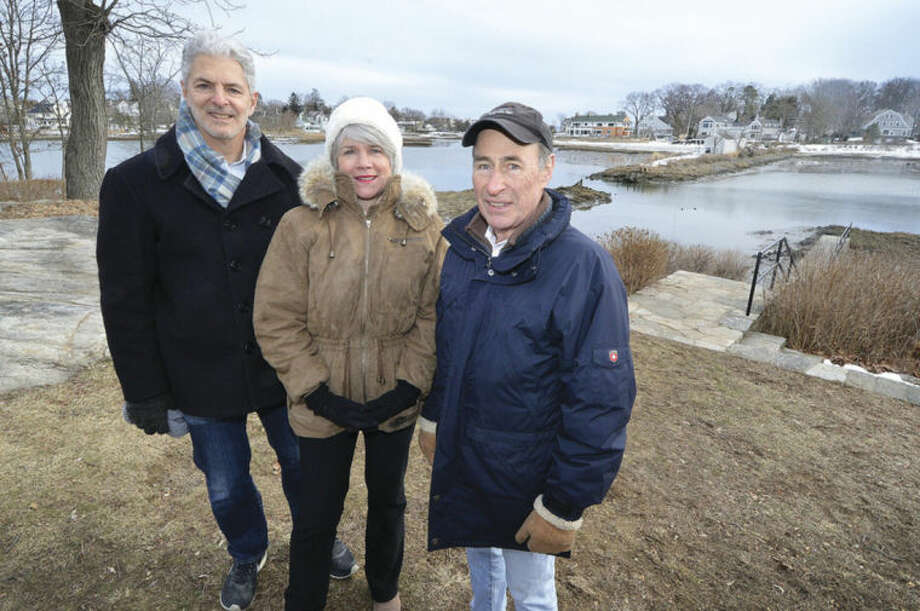 Hour photo / Alex von KleydorffBruce Beinfield, Norwalk Land Trust President Kathy Siever and Chuck Schoendorf , a founder of Farm Creek Preserve, stand across from the Nearwater Lane property that Bruce Beinfield will make available to the trust.