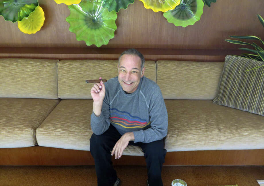 "FILE - This Aug. 12, 2013 file photo shows Sam Simon, co-creator of ""The Simpsons,"" at his home in Pacific Palisades, Calif. Simon, who made a midlife career shift into philanthropy and channeled much of his personal fortune into social causes including animal welfare, has died Sunday, March 8, 2015, after a long bout with cancer. He was 59. (AP Photo/Frazier Moore, File)"