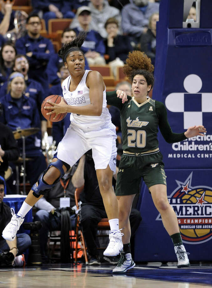 Connecticut's Morgan Tuck grabs a rebound from USF's Laura Ferreira (20) during the first half of an NCAA college basketball game in the finals of the American Athletic Conference tournament in Uncasville, Conn., on Monday, March 9, 2015. (AP Photo/Fred Beckham)