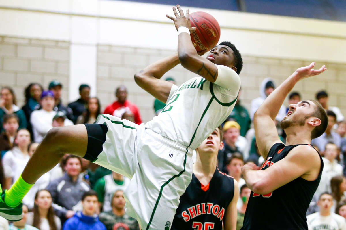 Hour photo/Chris Palermo. Zaire Wilson falls back on a shot during the Bears' Class LL state tournament first round win over Shelton High School Monday night.