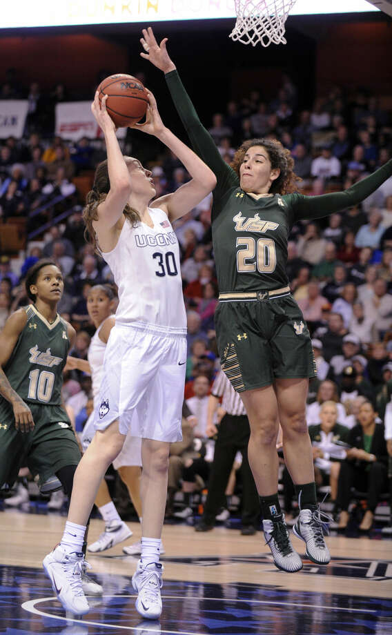 Connecticut's Breanna Stewart (30) is guarded by USF's Laura Ferreira (20) during the first half of an NCAA college basketball game in the finals of the American Athletic Conference tournament in Uncasville, Conn., on Monday, March 9, 2015. (AP Photo/Fred Beckham)