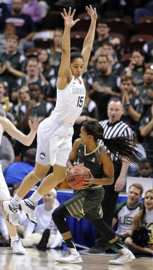 Connecticut's Gabby Williams (15) guards USF's Courtney Williams (10) during the second half of Connecticut's 84-70 victory in an NCAA college basketball game in the finals of the American Athletic Conference tournament in Uncasville, Conn., on Monday, March 9, 2015. (AP Photo/Fred Beckham)